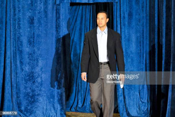 Golfer Tiger Woods arrives to speak at a press conference at TPC Sawgrass Clubhouse, headquarters of the PGA Tour, in Ponte Vedra Beach, Florida,...