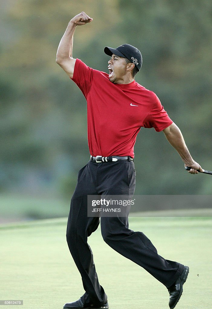 US golfer Tiger Woods celebrates after making the winning putt 10 April 2005 during the final round of the 2005 Masters Golf Tournament at the Augusta National Golf Club in Augusta, Georgia. Woods beat fellow American Chris DiMarco in a one-hole playoff. AFP PHOTO/Jeff HAYNES