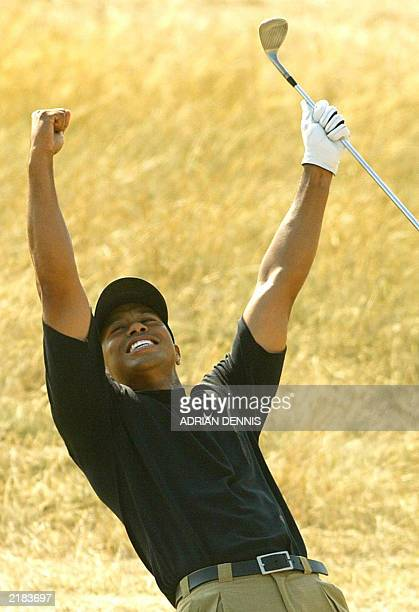 Golfer Tiger Woods celebrates an eagle putt on the 7th green during the third round at The Open Championship at Royal St. George's in Sandwich 19...
