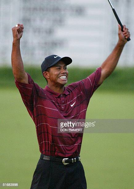 US golfer Tiger Woods celebrates his win on the 18th green 16 June in the 2002 US Open Championship at Bethpage Black in Farmingdale NY AFP PHOTO/Don...