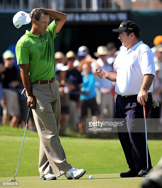 US golfer Tiger Woods chats with Australian golfer Craig Parry during his first practice round for the Australian Masters at the Kingston Heath golf...