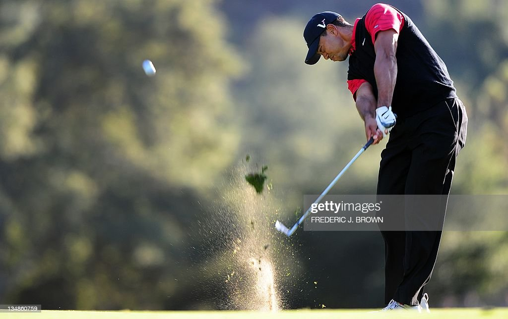 US golfer Tiger Woods connects on approa : News Photo