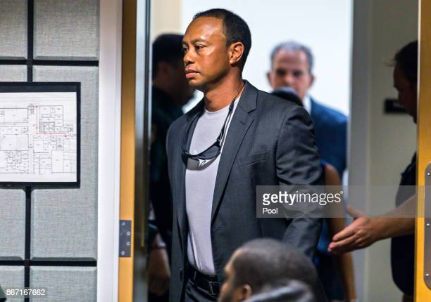 Golfer Tiger Woods enters Palm Beach County court October 27 2017 in Palm Beach Gardens Florida Woods plead guilty to a seconddegree misdemeanor...