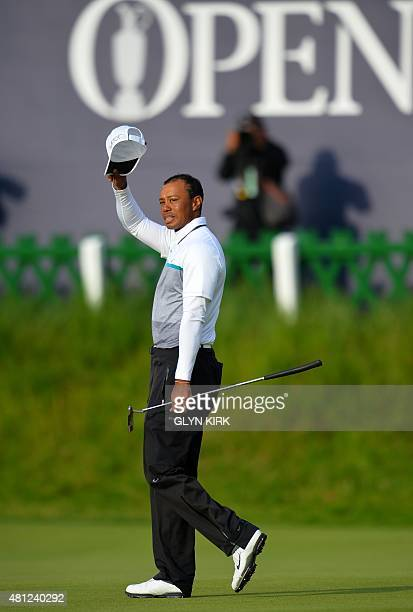US golfer Tiger Woods gestures on the 18th green during the completion of his second round 75 on day three of the 2015 British Open Golf Championship...