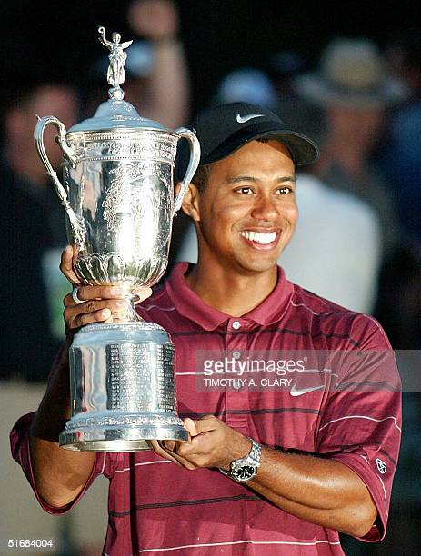 US golfer Tiger Woods holds the trophy after winning the 102nd US Open Championship 16 June 2002 at Bethpage State Park in Farmingdale NY Woods won...