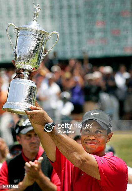 Golfer Tiger Woods holds up the trophy after winning the 108th US Open at Torrey Pines Golf Course in La Jolla California US on Monday June 16 2008...