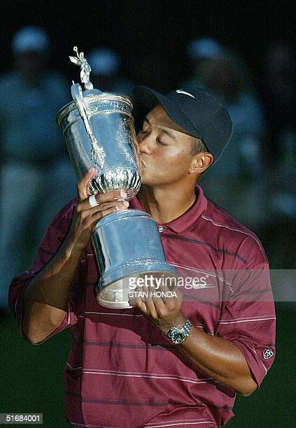 Golfer Tiger Woods kisses the trophy after winning the 102nd US Open Championship 16 June, 2002 at Bethpage State Park in Farmingdale, NY. Woods won...