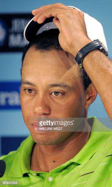 Golfer Tiger Woods listens to a question during a press conference following his first practice round for the Australian Masters at the Kingston...