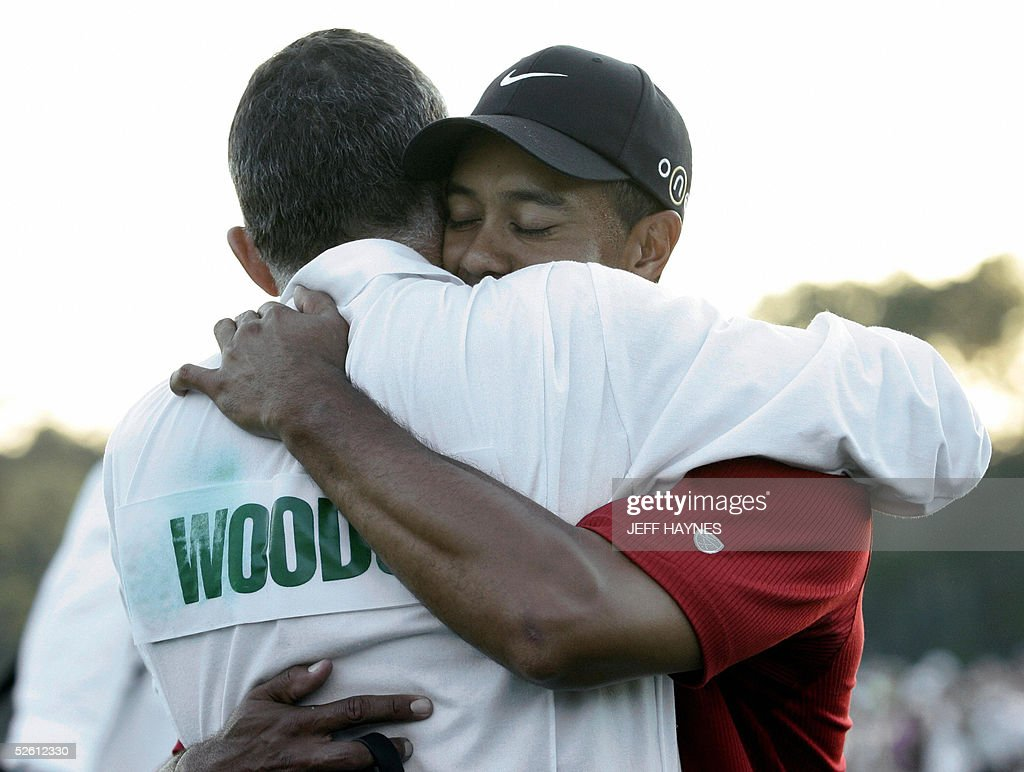 Golfer Tiger Woods (R) of the US celebrates with his caddie Steve Williams after making the winning putt on the 18th green 10 April 2005 during the final round of the 2005 Masters Golf Tournament at the Augusta National Golf Club in Augusta, Georgia. Woods beat fellow American Chris DiMarco in a one-hole play-off to take his fourth Masters title. AFP PHOTO/Jeff HAYNES