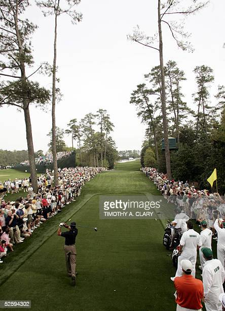 Golfer Tiger Woods of the US hits his tee shot on the 18th hole 06 April 2005 during the third practice round for the 2005 Masters Golf Tournament at...