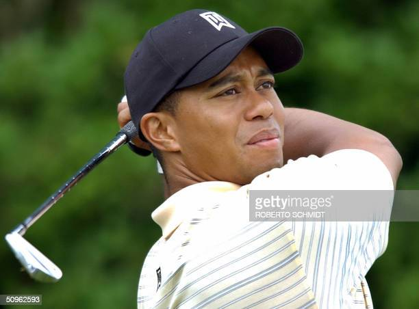 Golfer Tiger Woods of the US hits off the 10th tee during the second day of practice in preparation for the 2004 US Open Championship at Shinnecock...