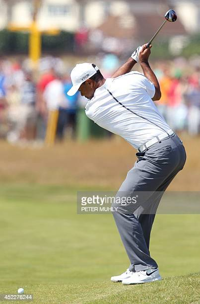 Golfer Tiger Woods plays from the 16th fairway during his first round 69, on the opening day of the 2014 British Open Golf Championship at Royal...