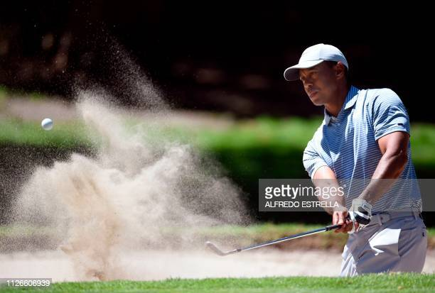 Golfer Tiger Woods plays his shot at green 1, during the first round of the World Golf Championship at the Chapultepec Golf Club in Mexico City on...