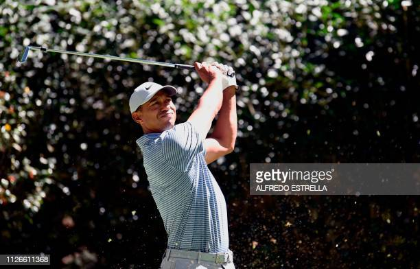Golfer Tiger Woods plays his shot at tee 3 during the first round of the World Golf Championship in Mexico City, at Chapultepec's Golf Club in Mexico...