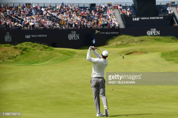 Golfer Tiger Woods plays onto the 18th green during a practice session at The 148th Open golf Championship at Royal Portrush golf club in Northern...