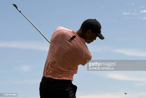 Golfer Tiger Woods practises a shot during the second round of the World Golf Championship in Mexico City, on February 22, 2019. - The WGC-Mexico...