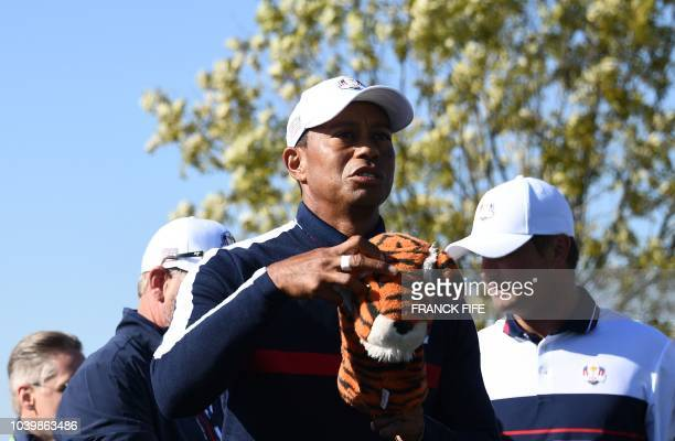 US golfer Tiger Woods prepares to tee off during a practice session ahead of the 42nd Ryder Cup at Le Golf National Course at SaintQuentinenYvelines...