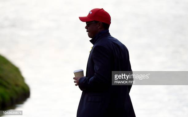 US golfer Tiger Woods reacts after Europe won the 42nd Ryder Cup at Le Golf National Course at SaintQuentinenYvelines southwest of Paris on September...