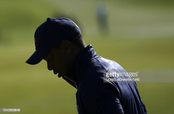 US golfer Tiger Woods reacts during his fourball match on the second day of the 42nd Ryder Cup at Le Golf National Course at SaintQuentinenYvelines...