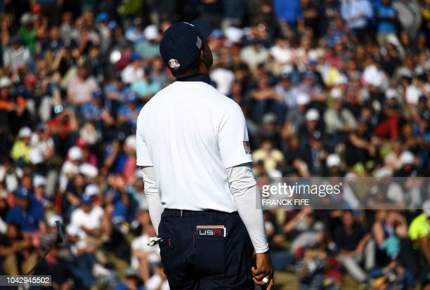 US golfer Tiger Woods reacts during his foursomes match on the second day of the 42nd Ryder Cup at Le Golf National Course at SaintQuentinenYvelines...
