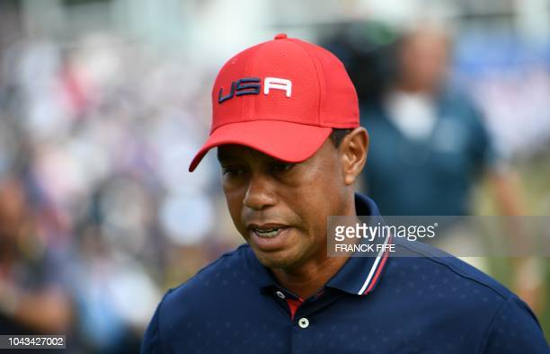TOPSHOT US golfer Tiger Woods reacts during his singles match with Europe's Spanish golfer Jon Rahm on the third day of the 42nd Ryder Cup at Le Golf...