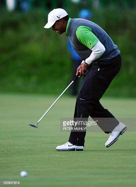 US golfer Tiger Woods reacts to his narrow eagle putt miss on the 18th Green during his second round on day two of the British Open Golf Championship...