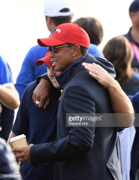 US golfer Tiger Woods reacts with US golfer Patrick Reed after Europe won the 42nd Ryder Cup at Le Golf National Course at SaintQuentinenYvelines...