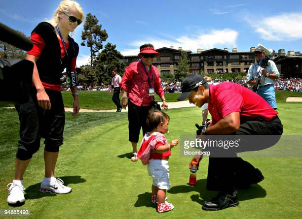 Golfer Tiger Woods, right, greets his daughter Sam, center, as his wife Elin, left, looks on after Tiger won the 108th U.S. Open at Torrey Pines Golf...