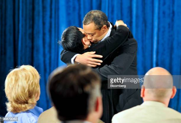 Golfer Tiger Woods, right, hugs his mother Kultida Woods during a press conference at TPC Sawgrass Clubhouse, headquarters of the PGA Tour, in Ponte...