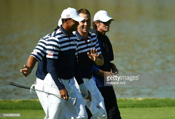 US golfer Tiger Woods shares a light moment with US golfer Justin Thomas during a practice session ahead of the 42nd Ryder Cup at Le Golf National...
