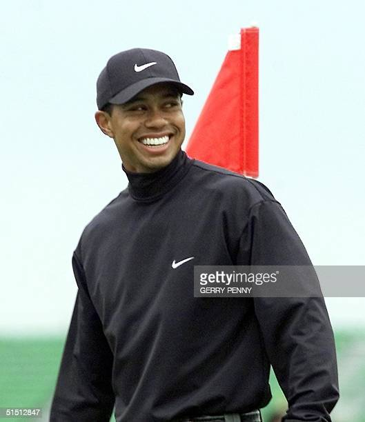 Golfer Tiger Woods smiles 18 July 2001 during the morning's practice round at the Royal Lytham and St Annes Golf Club for the 130th Open...