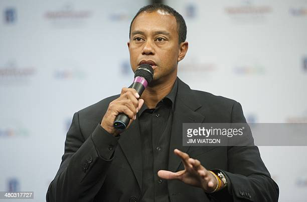 US golfer Tiger Woods talks about his back injury and the future of his sponsored tournament now named the Quicken Loans National during a press...