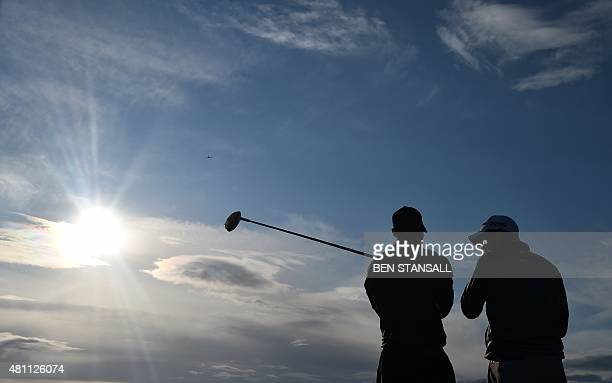 US golfer Tiger Woods talks to Australia's Jason Day on the 5th tee during their second round on day two of the 2015 British Open Golf Championship...