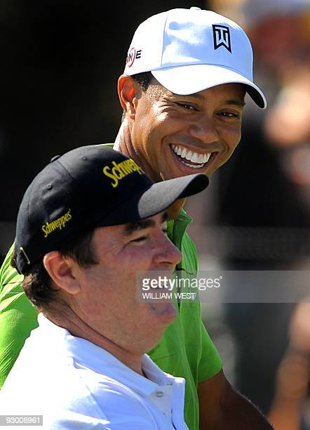 US golfer Tiger Woods talks with Australian golfer Craig Parry during his first practice round for the Australian Masters his first tournament in...