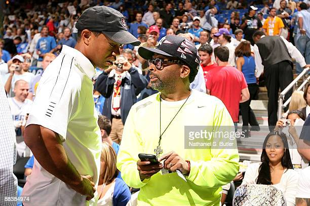 Golfer Tiger Woods talks with Director Spike Lee prior to Game Three of the 2009 NBA Finals betweeb the Los Angeles Lakers and the Orlando Magic at...
