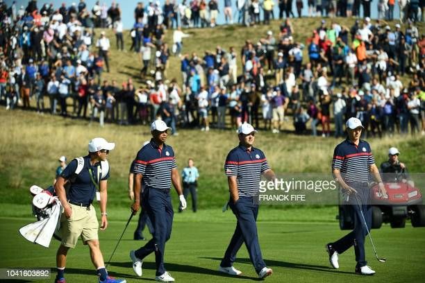 US golfer Tiger Woods US golfer Patrick Reed and US golfer Jordan Spieth walk during a practice session ahead of the 42nd Ryder Cup at Le Golf...