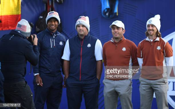 US golfer Tiger Woods US golfer Patrick Reed Europe's Italian golfer Francesco Molinari and Europe's English golfer Tommy Fleetwood pose before their...