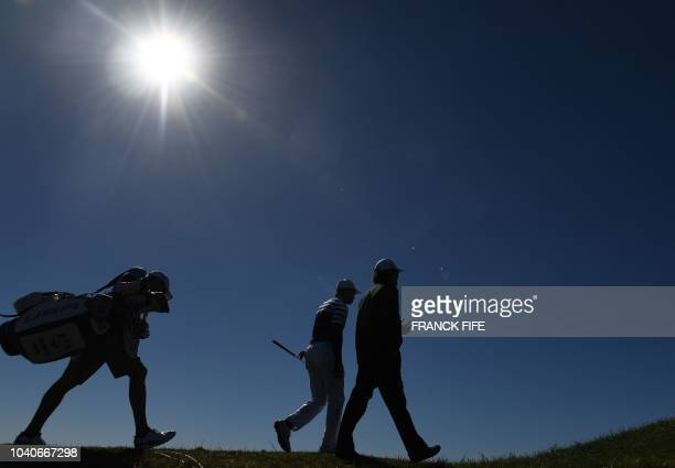 TOPSHOT US golfer Tiger Woods walks during a practice session ahead of the 42nd Ryder Cup at Le Golf National Course at SaintQuentinenYvelines...