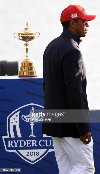 TOPSHOT US golfer Tiger Woods walks past the trophy after Europe won the tournament on the third day of the 42nd Ryder Cup at Le Golf National Course...