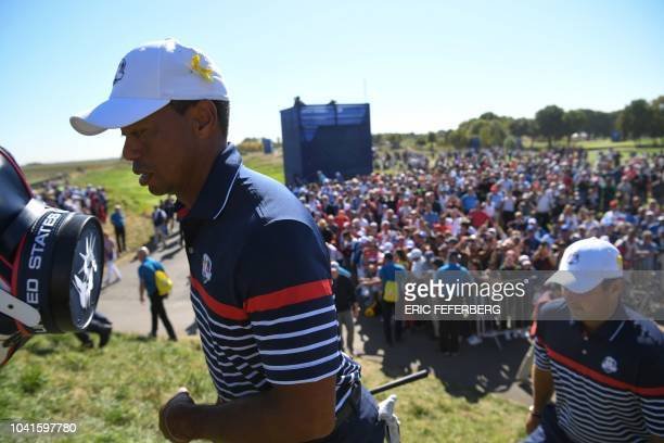 US golfer Tiger Woods walks with US golfer Patrick Reed during a practice session ahead of the 42nd Ryder Cup at Le Golf National Course at...