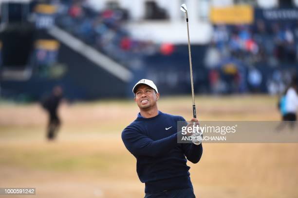 TOPSHOT US golfer Tiger Woods watches his approach from the 1st fairway during a practice round at The 147th Open golf Championship at Carnoustie...