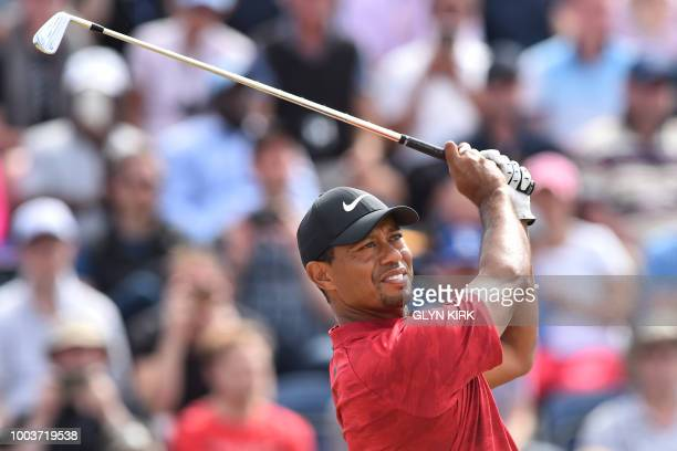 TOPSHOT US golfer Tiger Woods watches his iron shot from the 3rd tee during his final round on day 4 of The 147th Open golf Championship at...