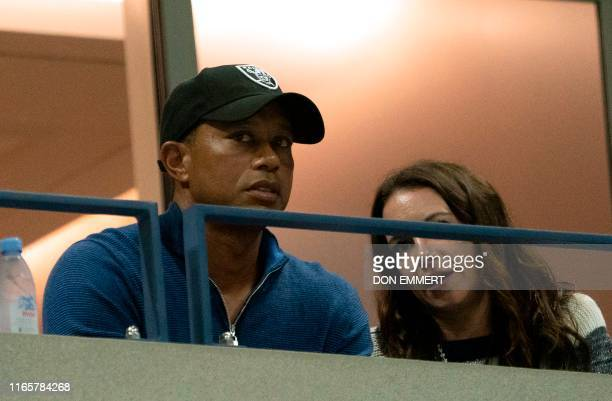 US golfer Tiger Woods watches the match between Rafael Nadal of Spain and Marin Cilic of Croatia during their Round Four Men's Singles match at the...