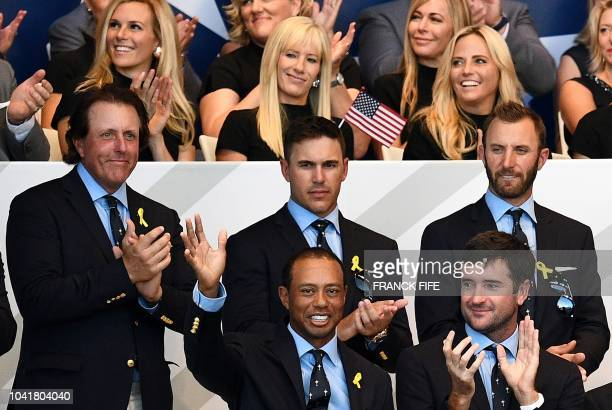 TOPSHOT US golfer Tiger Woods waves after receving a standing ovation during the opening ceremony of the 42nd Ryder Cup at Le Golf National Course at...