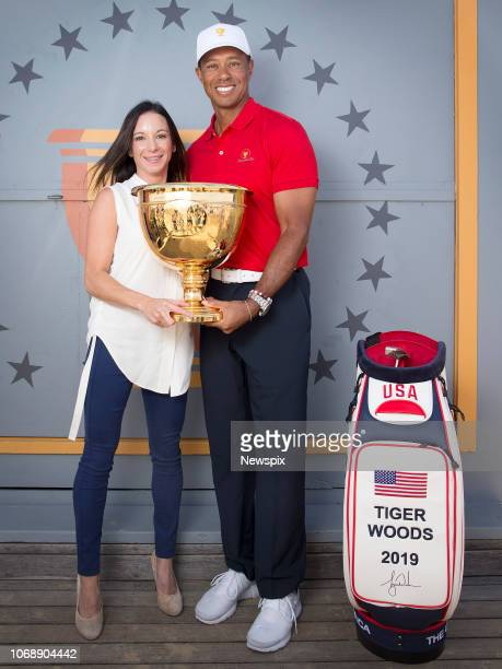 MELBOURNE VIC Golfer Tiger Woods with Erica Herman promotes next years Presidents Cup at Eureka Tower in Melbourne Victoria