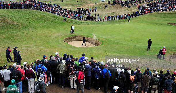 Golfer Tom Watson plays out of a bunker onto the 6th green on the final day of the 140th British Open Golf championship at Royal St George's in...