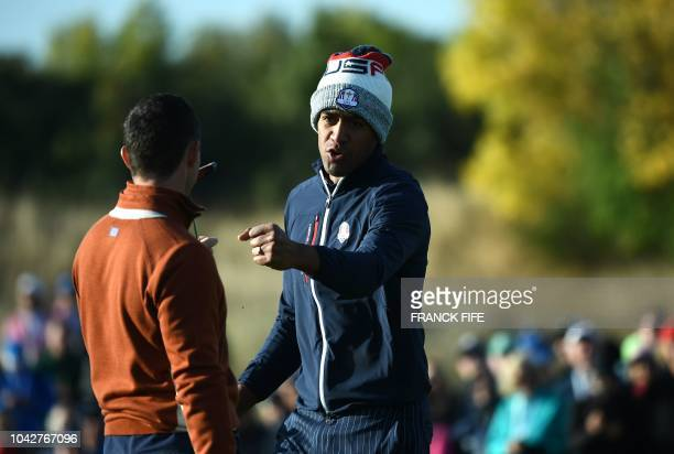 US golfer Tony Finau and Europe's Northern Irish golfer Rory McIlroy react during his fourball match on the second day of the 42nd Ryder Cup at Le...