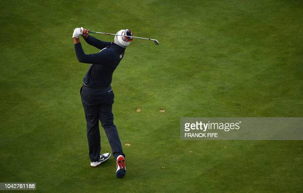 Golfer Tony Finau plays a tee shot during his fourball match on the second day of the 42nd Ryder Cup at Le Golf National Course at...