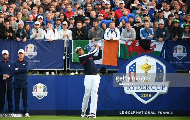 TOPSHOT US golfer Tony Finau plays the first tee shot during his fourball match on the first day of the 42nd Ryder Cup at Le Golf National Course at...