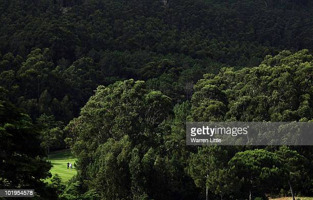 A golfer waits to play his second shot into the the 16th green during the first round of the Estoril Open de Portugal at Penha Longa Golf Club on...